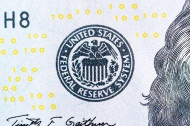 Federal reserve system symbol on hundred dollar bill closeup mac