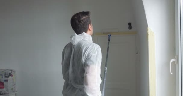 young man painting his new home,
