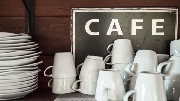 Coffee cups with sign in cafe