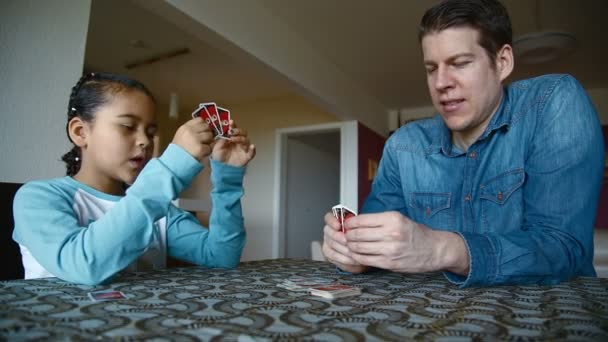 Father and daughter playing cards