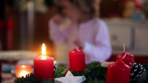 Close up of an candle on a wreath on advent first