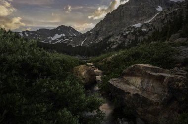 Pear Creek leading into Pear Lake at sunset, Copeland Mountain and Elk Tooth in the background, summer time, Rocky Mountain National Park Colorado