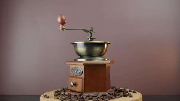 Vintage coffee grinder with coffee beans. Manual coffee machine