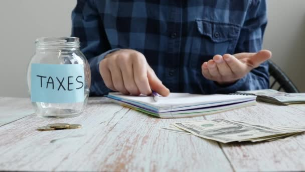Man analyzing monthly budget, saving money for unpaid taxes. Planning budget