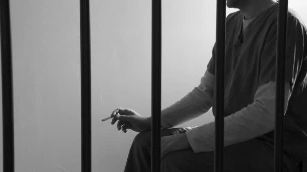prisoner smoking cigarette