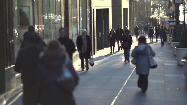 zaneprázdněný chodník ráno v New Yorku