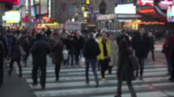 people crossing a busy street in NYC