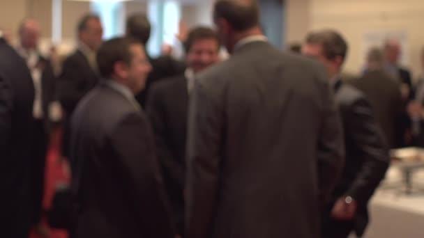 Fotografie Geschäftsleute im Gespräch bei Business-Konferenz
