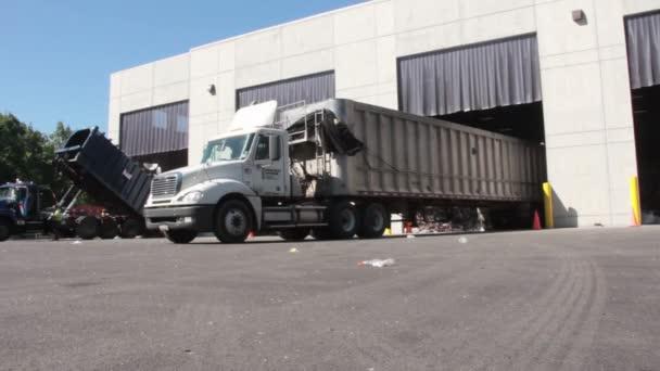 Large truck unloading trash