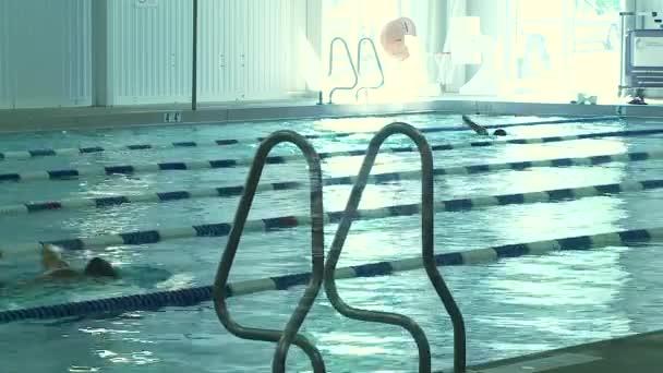 Swimming laps in pool