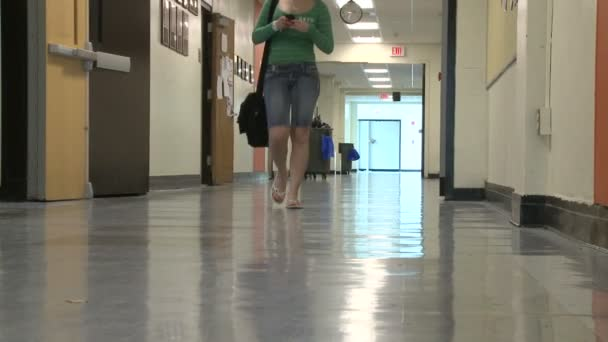 One student walking in hallway (1 of 3)