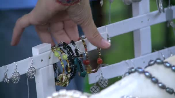 Looking at bracelets at a Craft Fair.