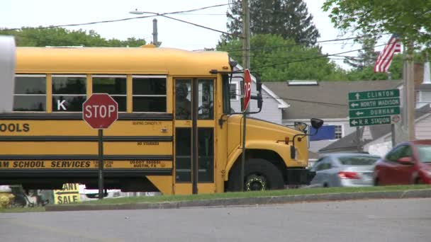 A school bus coming through town on its route  (2 of 2)