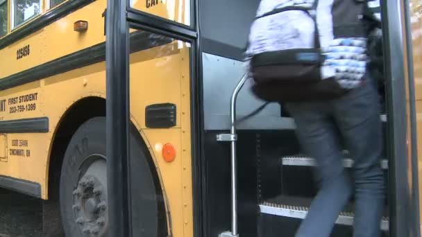 Students getting on bus. (2 of 3)