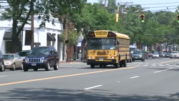 School bus driving through downtown. (1 of 2)