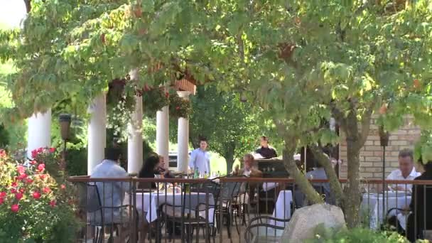 People dining on a patio outside a restaurant