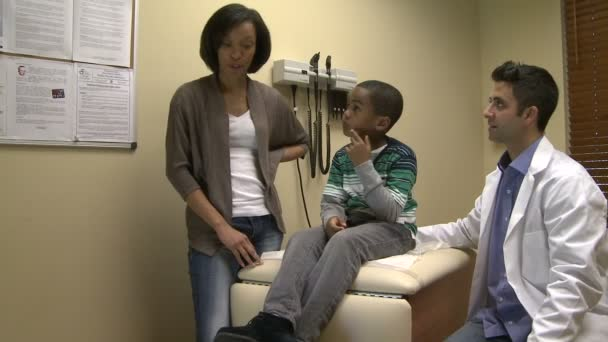 A doctor examines a young patient