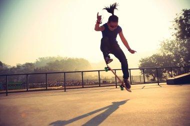 skateboarder skateboarding at park