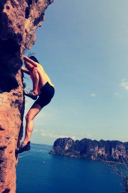 woman rock climber at rock