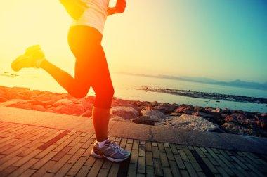 Runner athlete running at seaside.