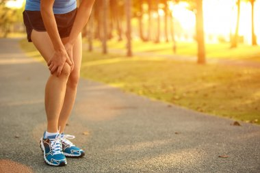 Woman runner  injured leg