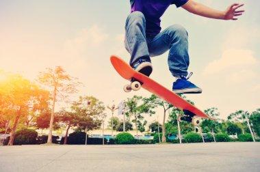 Skateboarding woman sunrise
