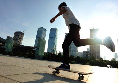 Skateboarder skateboarding at sunrise city stock vector