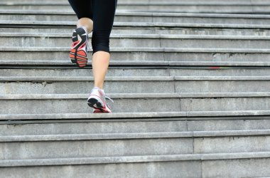 Woman legs running on  stairs