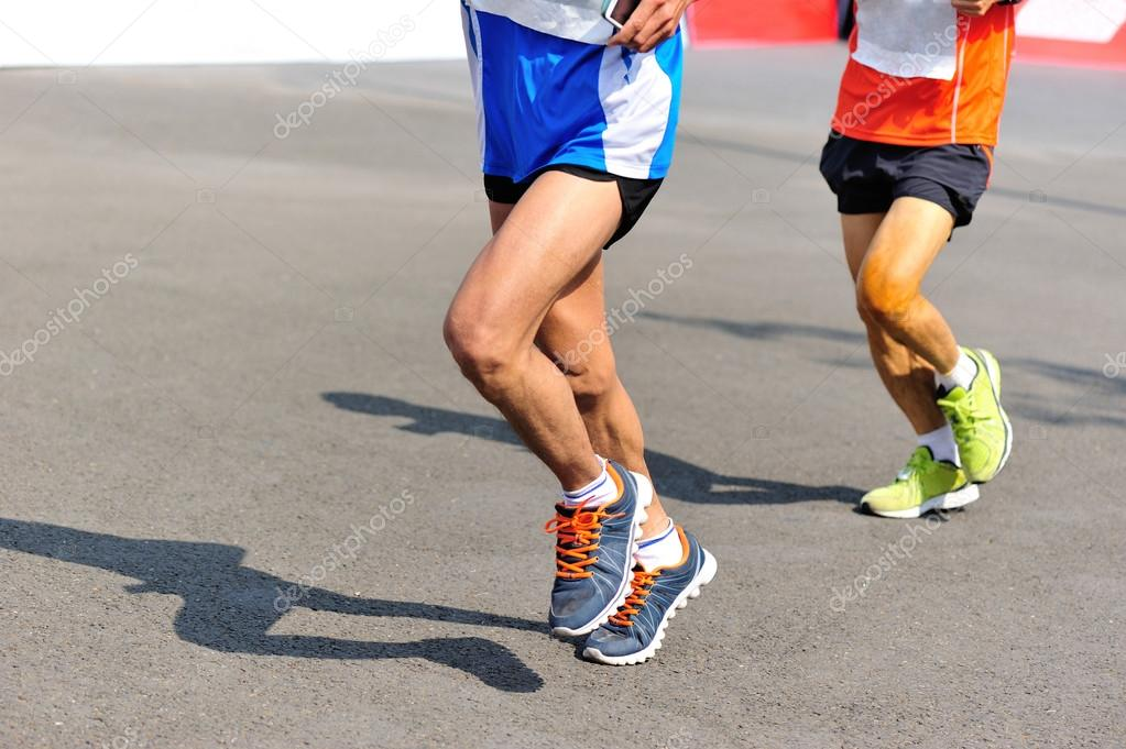 Marathon Runner Legs Running On City Road Stock Photo