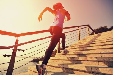 Runner athlete running up stairs