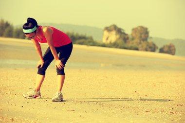Tired woman runner