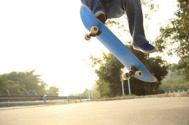 Skateboarder jumping at skatepark
