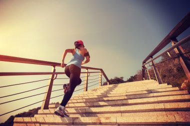 Sporty woman running up stairs