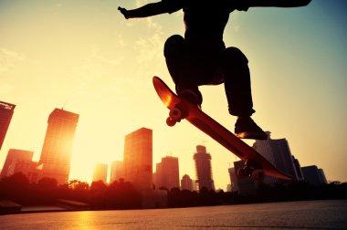 Female Skateboarder skateboarding over sunrise city stock vector