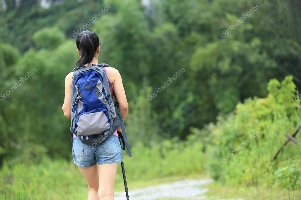 Female hiking on trail