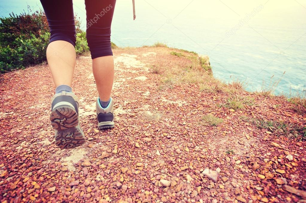 Woman hiking on seaside trail