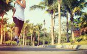 Fotografie Fitness female jogger legs running