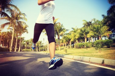 Fitness female jogger legs running