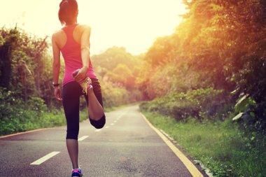 Woman runner warm up