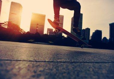 Skateboarder doing trick ollie