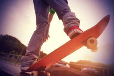 Female legs skateboarding