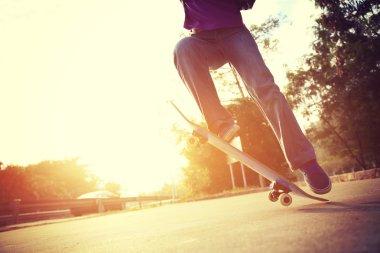 skateboarder jumping ollie