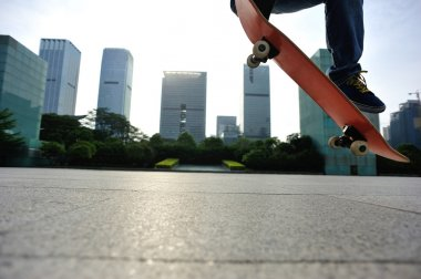 Skateboarder skateboarding at city