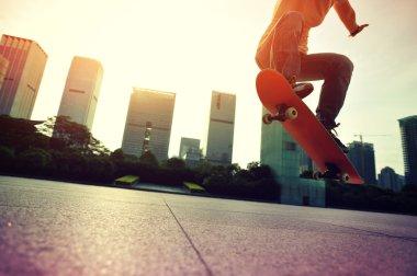 Skateboarder skateboarding over city