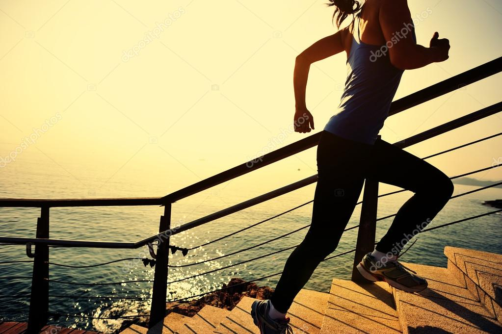 Healthy lifestyle woman running up