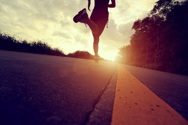 Runner athlete running at seaside road