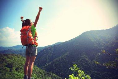 woman hiker at mountain peak