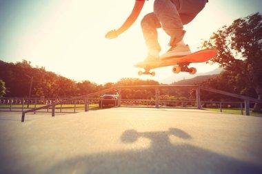Skateboarder legs on skateboard