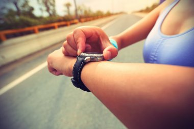 woman jogger with sport smart watch