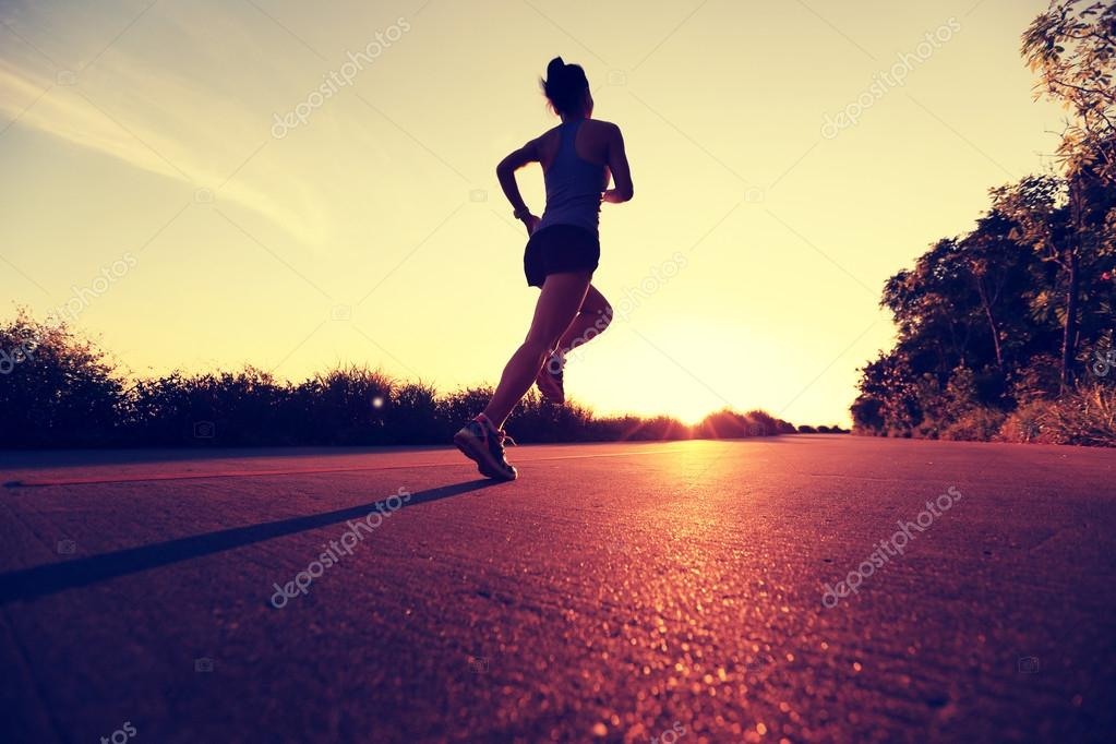 Young fitness woman running